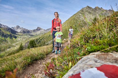 Families enjoy hiking trails in the mountainous landscape of Kappl