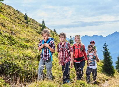 Families enjoy hiking trails in the mountain landscape in Kappl
