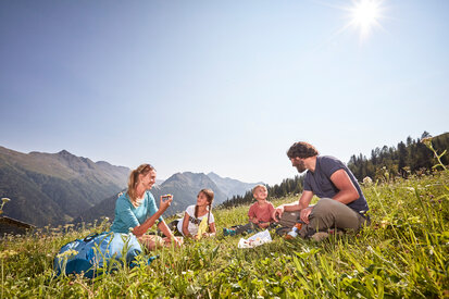 Families enjoy their snack in the hiking paradise Kappl