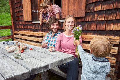 Families enjoy their time together in an alpine hut in the hiking paradise Kappl
