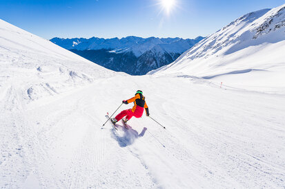 Holidaymakers enjoy the skiing experience on the Lattenabfahrt in the ski area Kappl in Paznaun