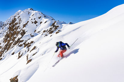 Holidaymakers enjoy a skiing experience in the ski area Kappl