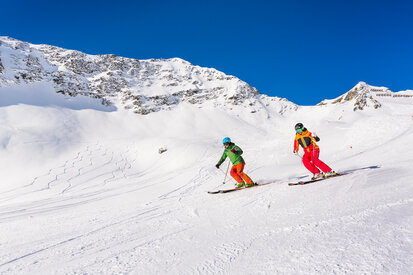 Skiers enjoy the well prepared slopes in the ski area Kappl
