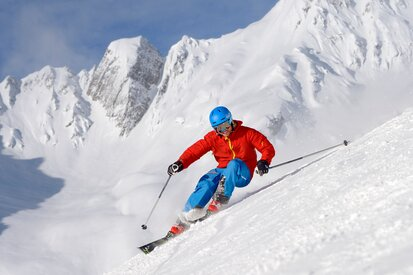 Skiers enjoy the well prepared slopes of the ski area Kappl