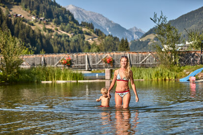 On hot summer days families get a dip in the lakeside of the region See